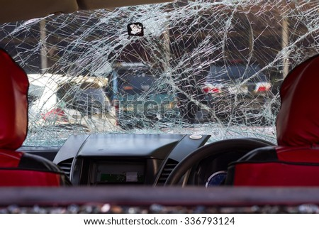 Looking back through the red seat to the windscreen to crack accidental damage. - stock photo