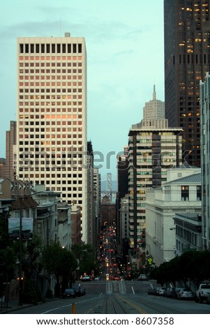 Looking down a hill in San Francisco towards the Bay Bridge - stock photo