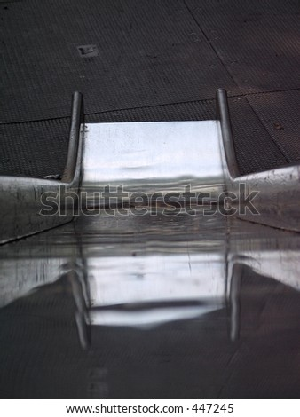 looking down a slide - stock photo