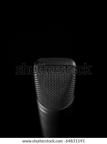 Looking down and isolated microphone. - stock photo
