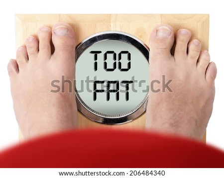 looking down at the scales far too overweight - stock photo