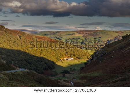 Looking down from Hill at valley farm, last few minutes of sunlight, evening, autumn, fall. Near Elan Valley, Powys, Wales, United Kingdom, Europe.  - stock photo