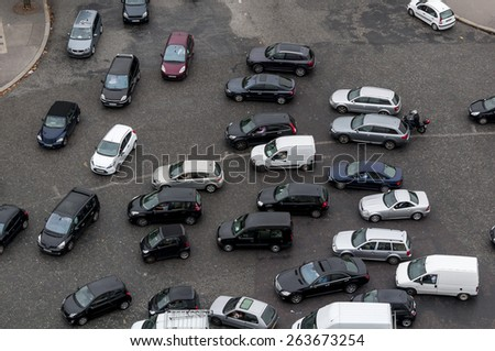 Looking down from the Arc de Triomphe on a traffic jam  on the Place Charles de Gaulle in Paris France. - stock photo