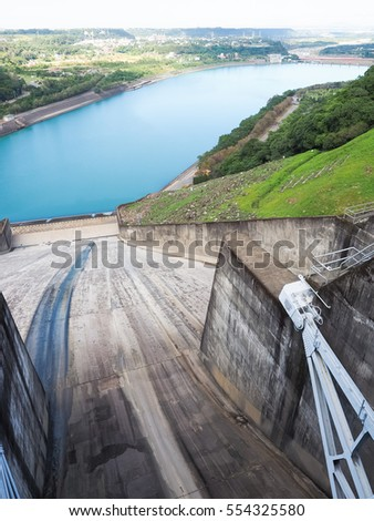 Looking down from the wall of a dam