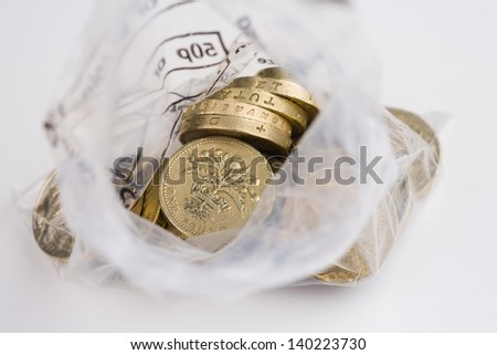 Looking down into an open money bag of pound coins - stock photo
