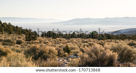 Looking Down Mountain Into Great Basin Nevada Desert Southwest - stock photo
