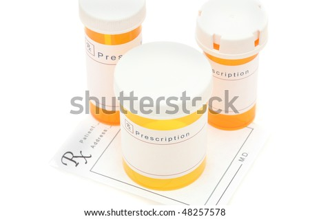 Looking down on a group of prescription bottles on Prescription Form  horizontal composition shallow depth of field - stock photo