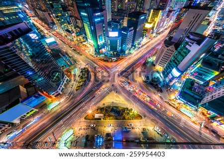 Looking down on a major interstection at night in Seoul, South Korea.