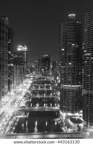 Looking down the Chicago River at night in Chicago, Illinois in black and white. - stock photo
