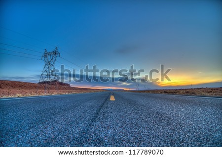 Looking Down the Highway at Sunset in Arizona - stock photo