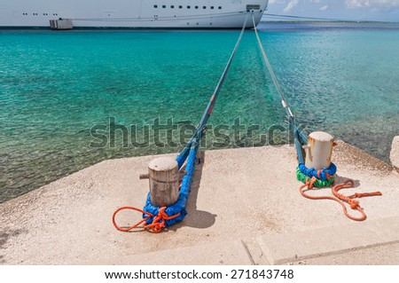 Looking down the Mooring Lines at Bow of Large Ship - stock photo