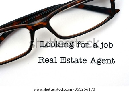 Looking for a job real estate agent - stock photo