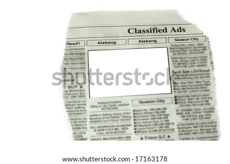 looking for something in newspaper - stock photo