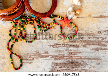 Looking for the summer. Marine frame in summer vacation concept with sand and summer accessories placed on wooden surface - stock photo