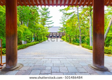 Looking from sidewalk, through entrance down main path to the Classical Golden Hall, Kondo, a national treasure, of the Toshodai-ji Buddhist temple in Nara, Japan. Horizontal