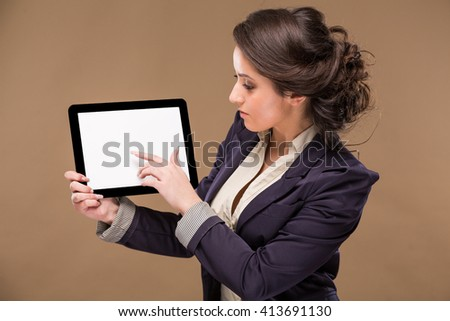 looking  girl with a tablet in hands