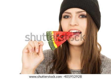 Looking hot. Casual stunning hipster woman biting candy. - stock photo