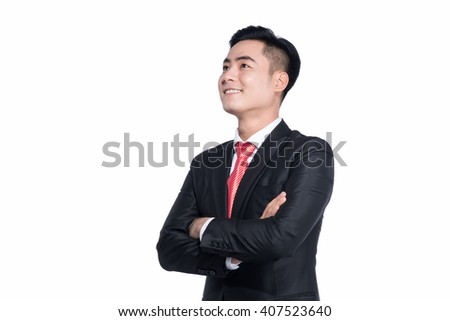 Looking in future with smile. Confident young man keeping arms crossed and looking away with smile while standing against white background