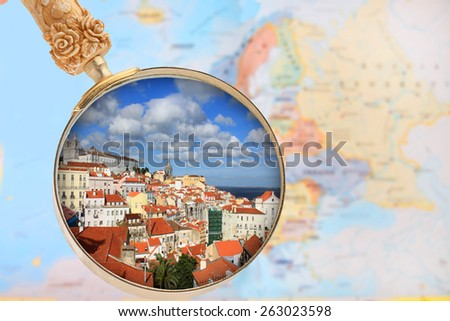 Looking in on Lisbon, Portugal with European map in the background - stock photo