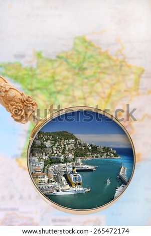 Looking in on Nice, France with blurred map in the background - stock photo