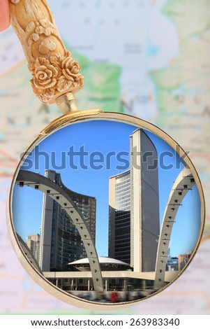 Looking in on Toronto, with blurred map of Ontario, Canada in the background - stock photo