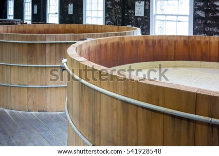 Looking into bourbon mash tanks in a distillery