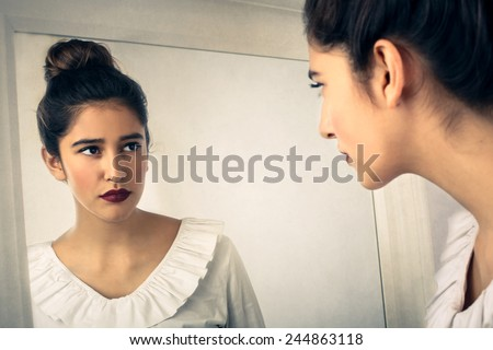 Looking into the mirror  - stock photo