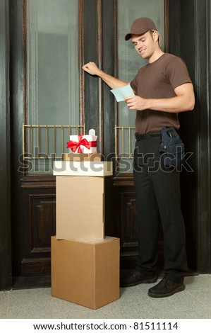 looking on his note for the packages - stock photo