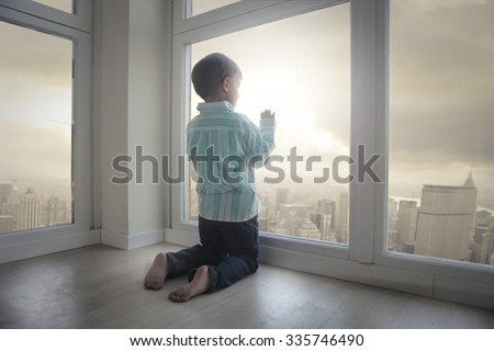 Looking out of the window - stock photo