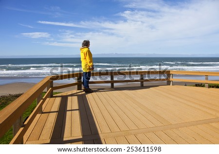 Looking out on the beach on the Oregon coast. - stock photo