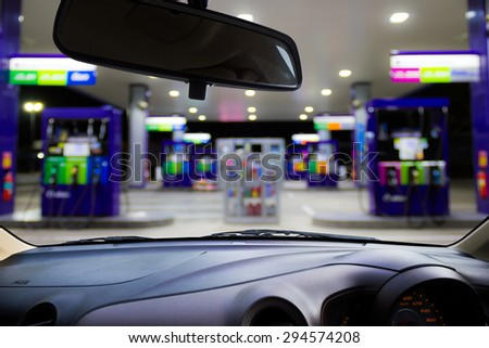 Looking out the car window to see gas station,use for product presentation related Images.  - stock photo