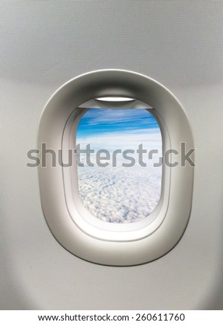 Looking out the window of a plane - stock photo