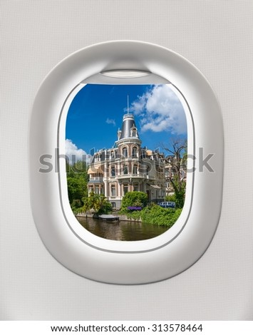 Looking out the window of a plane to the city of Amsterdam, Netherlands