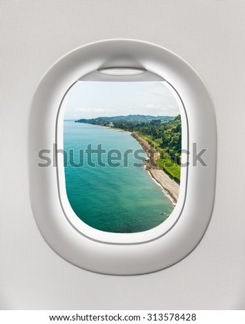 Looking out the window of a plane to the sea shore in Batumi, Georgia - stock photo