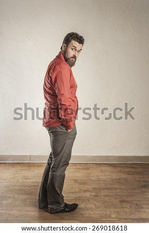 Looking over his shoulder - mature European man in red shirt.