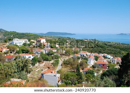 Looking over the roofs of Hora village towards Patitiri on the coast of the Greek island of Alonissos. The village was badly damaged by an earthquake in 1965. - stock photo