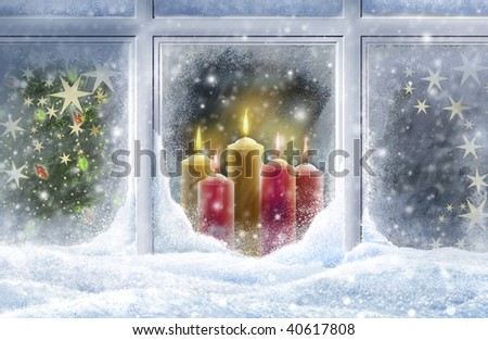 Looking through a snowy window at candles