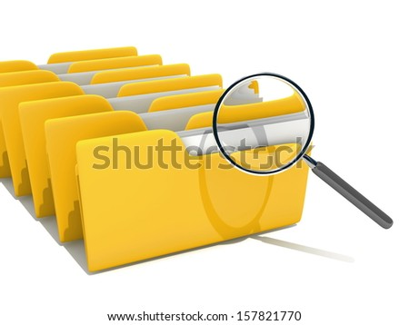 Looking through magnifying glass on papers in yellow folder - stock photo