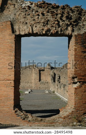 looking through ruins of a doorway in Pompeii Italy - stock photo