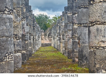 Looking through the columns at Chichen Itza - stock photo