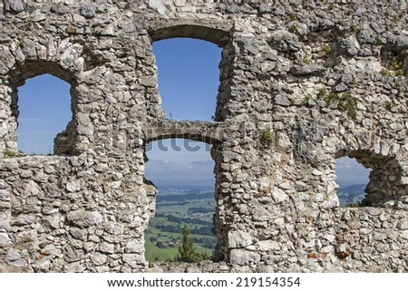 Looking through the window openings of Falkenstein Castle of the Allgaeu landscape - stock photo