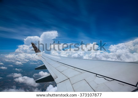 Looking through window aircraft during flight in wing with a  blue sky