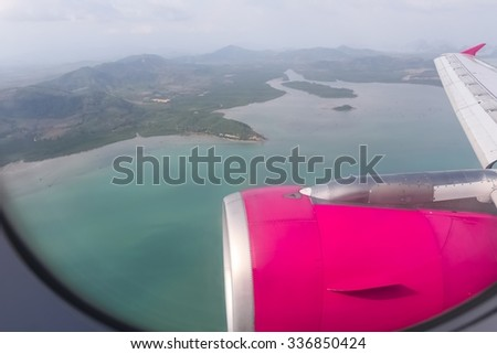 Looking through window aircraft during flight in wing with top view - stock photo