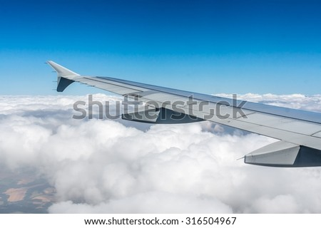 Looking through window airplane during flight in wing