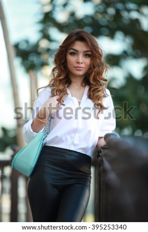 looking to camera, awesome fashion girl with bag, dubai beautiful model looking outside uae abudhabi girl