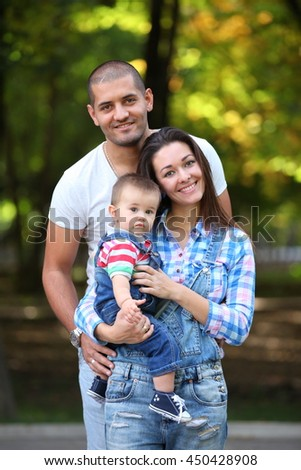 Looking to camera young family posing, after wedding, happiness  - stock photo