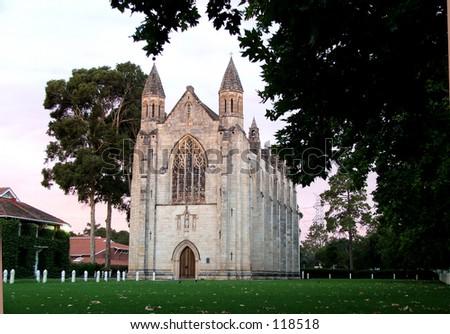 Looking to church through sugar gum tree - stock photo