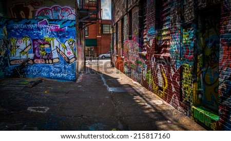 Looking toward Howard Street in the Graffiti Alley, Baltimore, Maryland. - stock photo