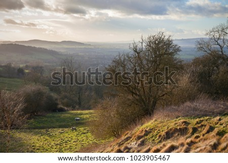 Looking towards Bredon Hill and the Malvern Hills over Broadway, Cotswolds, England.