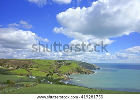 Looking towards Talland Bay which lies between Looe and Polperro on the Cornish coast, on a beautiful blue sky Spring day, Cornwall, England, UK
